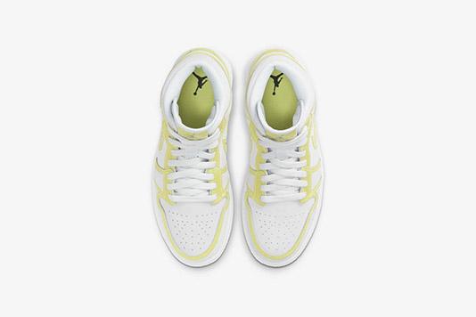 Une Air Jordan 1 Mid aux accents jaune fluo rejoint l'eshop de Nike